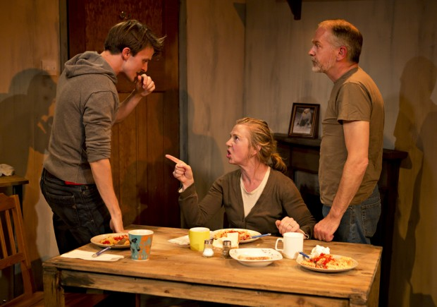 Richard Southgate, Maggie O'Brien and Paul Stonehouse in The Dogs of War. Photo: Pamela Raith